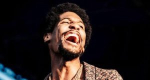 "Jon Batiste: Angel Leading The ""Boogie"" Riot"
